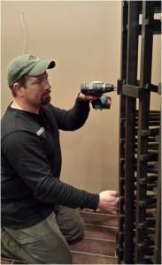 Philips contractor assembling wine racks